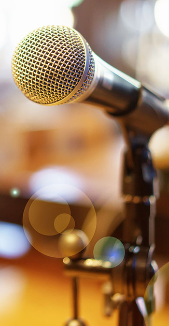 photo of a microphone on a desk being used for audio sermons